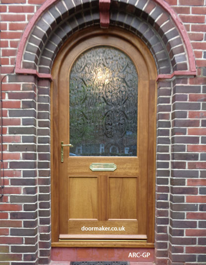 Iroko arched door - one glazed pane over 2 timber panels