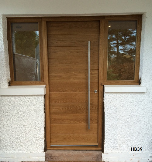 Contemporary horizontal boarded door and frame with 2 side windows