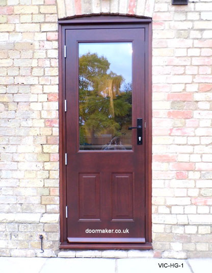 One glass pane victorian style iroko stained to a mahogany shade